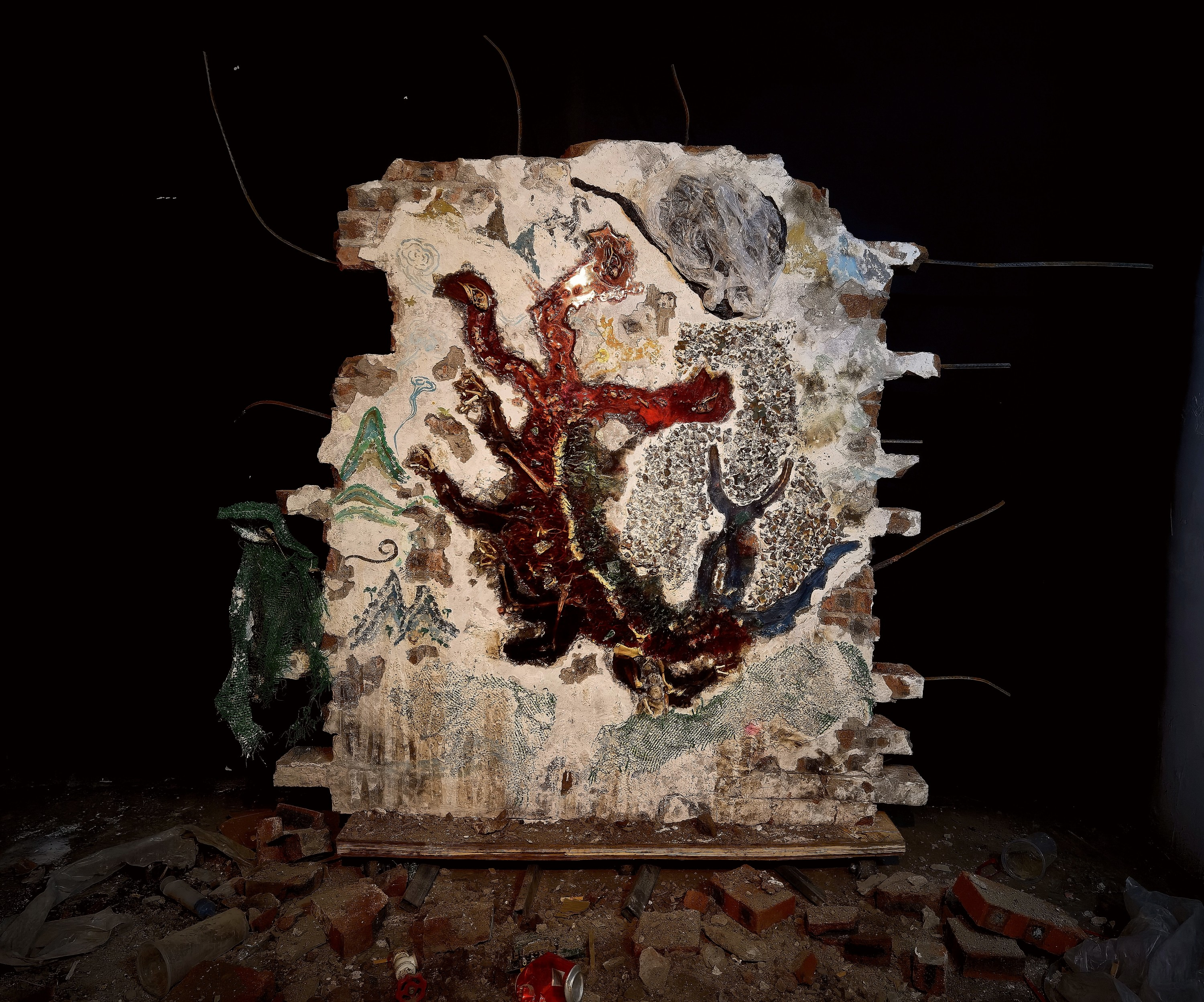 A monster made by colored epoxy inlay on the dilapidated brick wall.