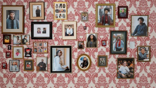 Wall-mounted and framed photographs of black MICA students and alumni