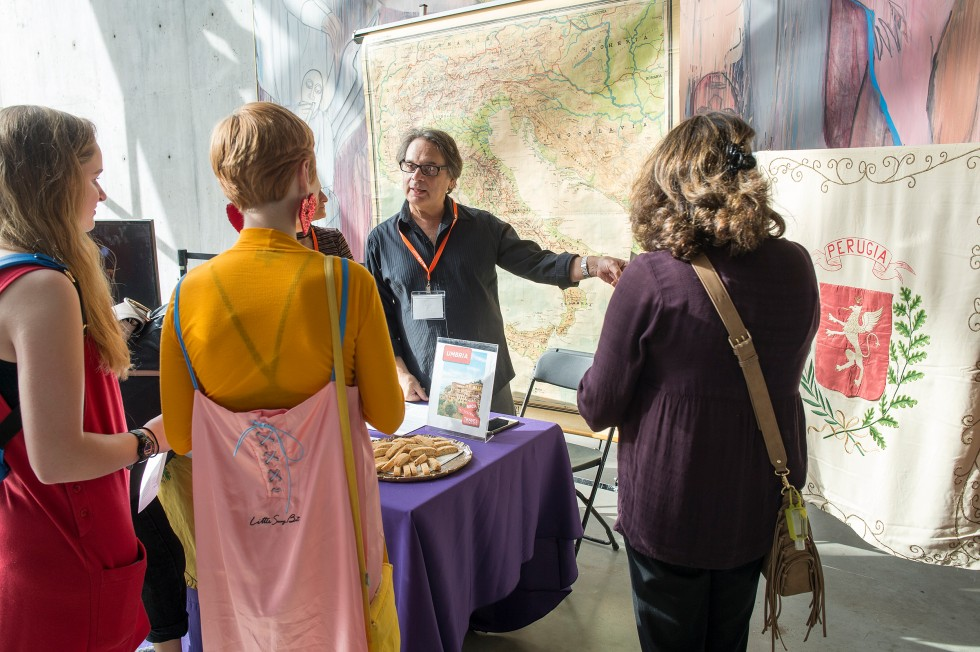 Parents talk to a MICA staff member at a table in the Brown Center