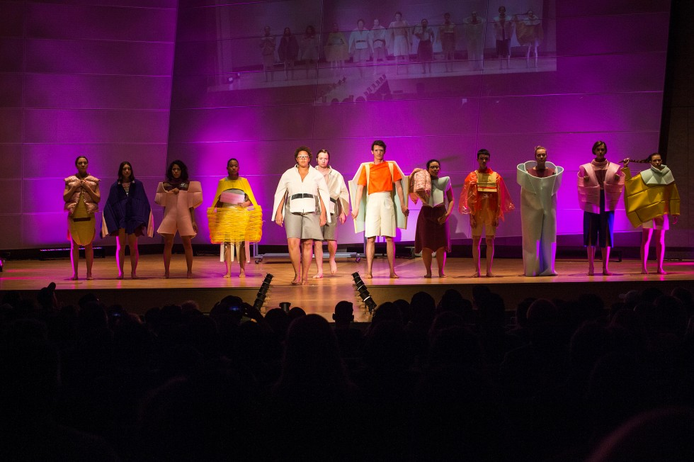 Line of of models showing a modern fashion line by a student in the Annual Benefit Fashion Show.