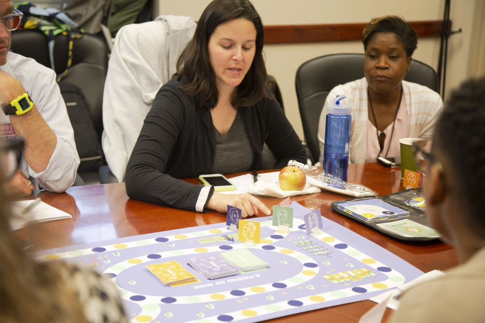 A photo of family planning practitioners playing the game during a shareback session.