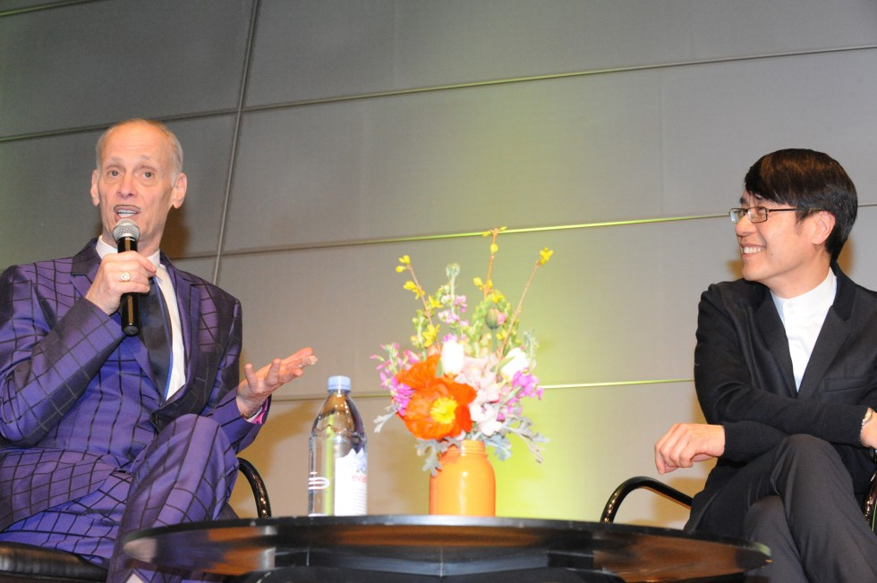 John Waters and Samuel Hoi on stage in the Brown Center.