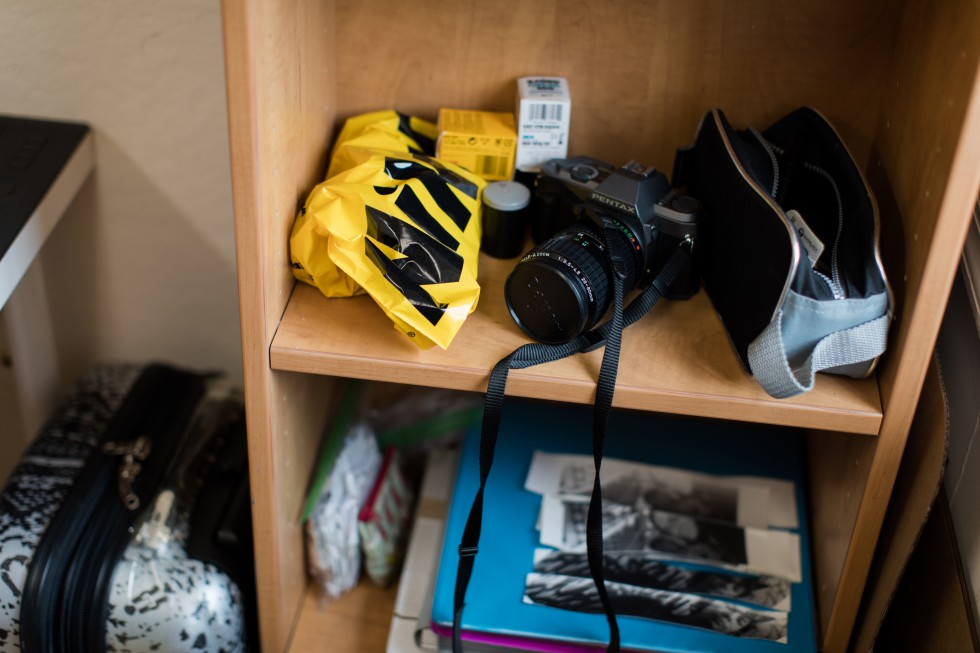 Camera on a bookshelf in a Meyerhoff House apartment.