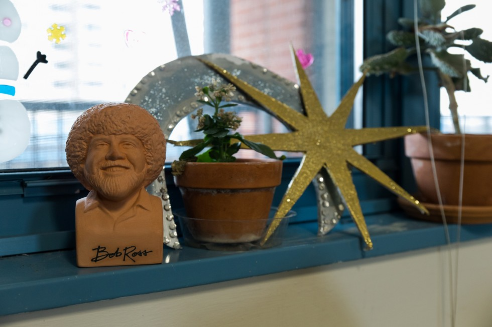 Plants and knickknacks sit on a window sill in a Carter Hall apartment.