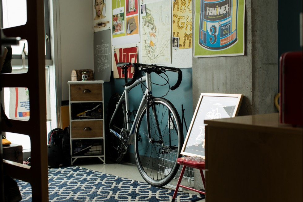 A bike leans against a wall in a Gateway apartment.
