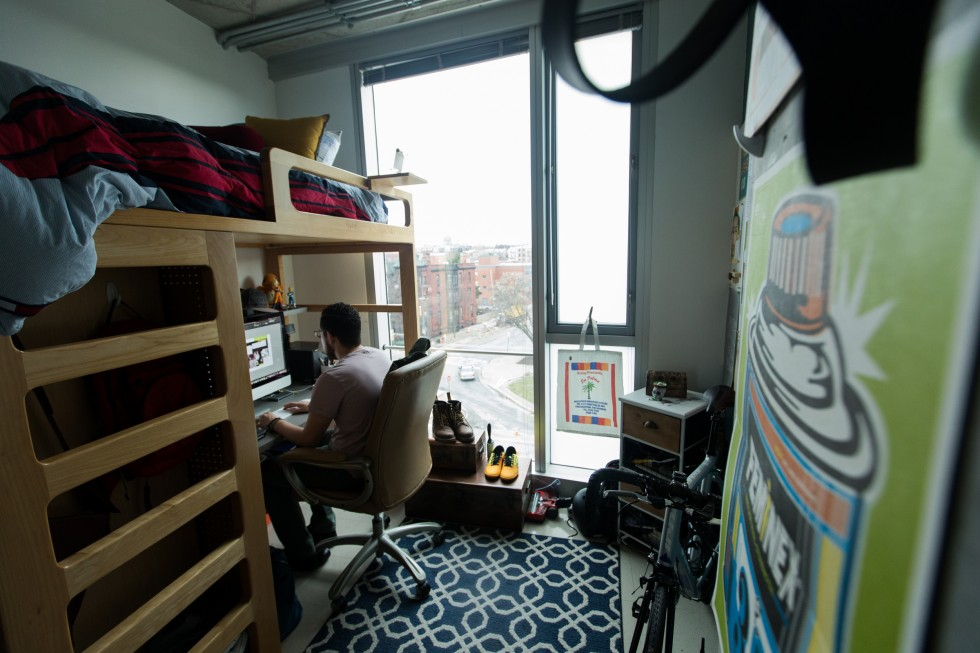 A student sits at a desk in a Gateway apartment