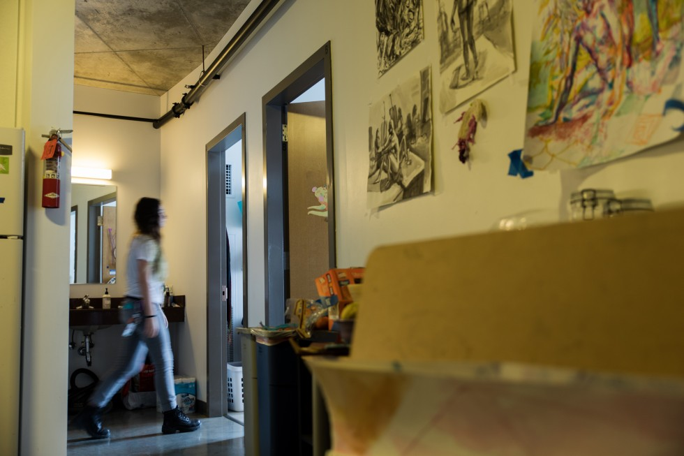 A student walks down a hall in a Gateway apartment.