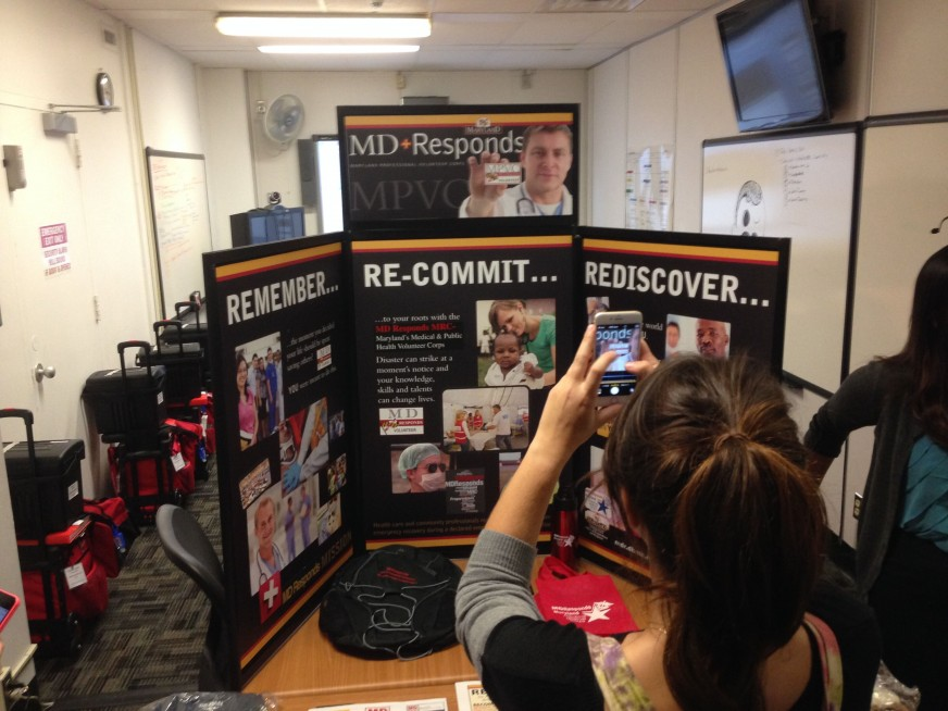 Students photographing a maryland responds display during observational research.