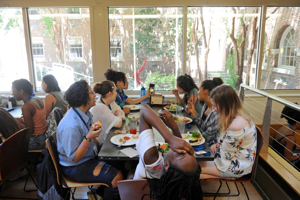 A group of students eating lunch in the Meyerhoff dining hall.