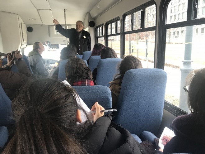 """A photo of students in a bus during a """"Toxic Tour"""" with Glen Ross"""