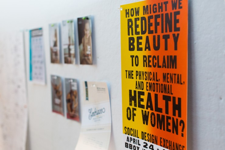 "A poster advertising the annual social design exchange. The poster reads ""How might we redefine beauty to reclaim the physical, mental, and emotional health of women?"""