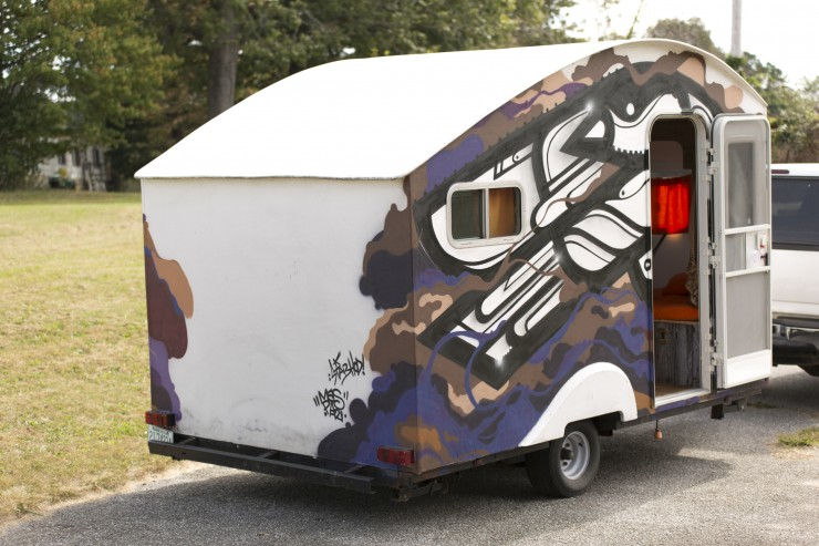 Rear shot of Byron Banghart's converted trailer, adorned in graffiti.
