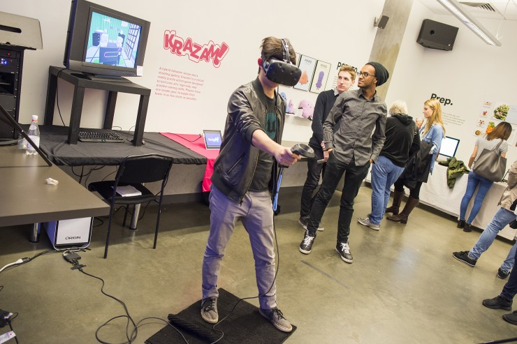 Student using a VR game at the Commencement Exhibition