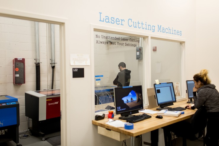 Students work on Laser Cutting Machines in the Digital Fabrication Lab