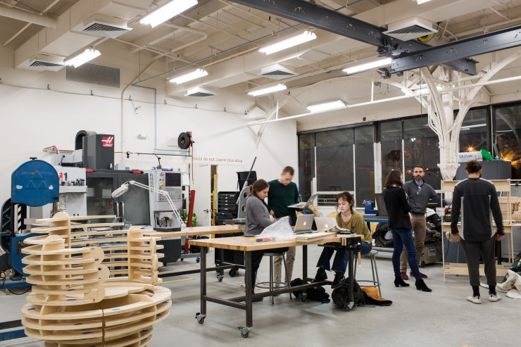 Students work in the Digital Fabrication Lab in the Station building.