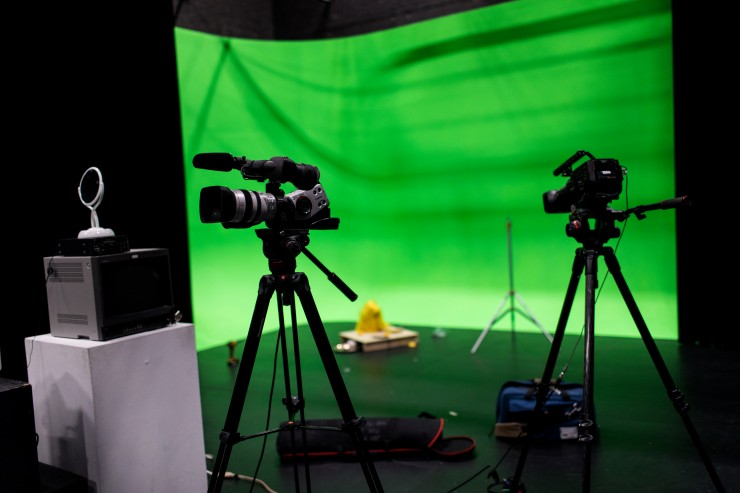 Cameras in the sound stage. A green screen is installed in the background.