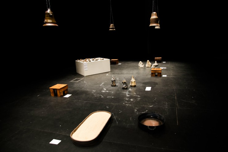An interactive art exhibition with bells and ceramic objects.