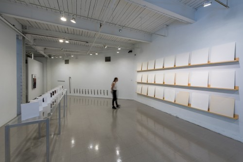 Installation consisting of large panes of plaster mounted in an exhibition space.
