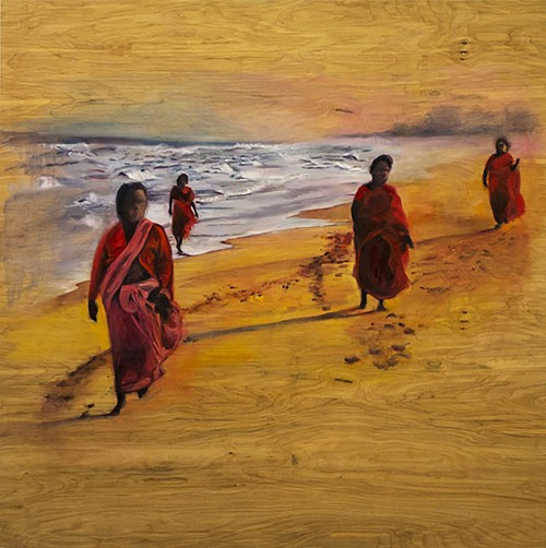 Painting of four women in bright red saris walking on the seashore. The woodgrain of the panel on which the piece is painted shows through in the sand beneath their feet.