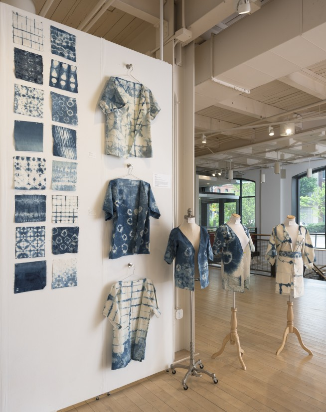 Samples of indigo dyed cloths and shirts made by students in Aura Evens' class.