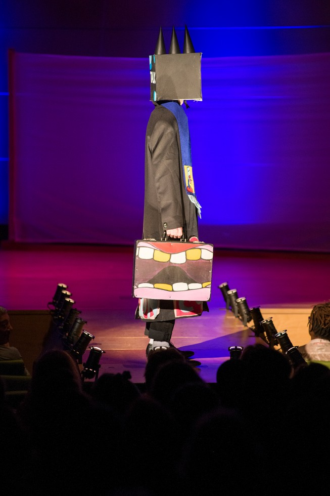 Annual Benefit Fashion Show model on stage.