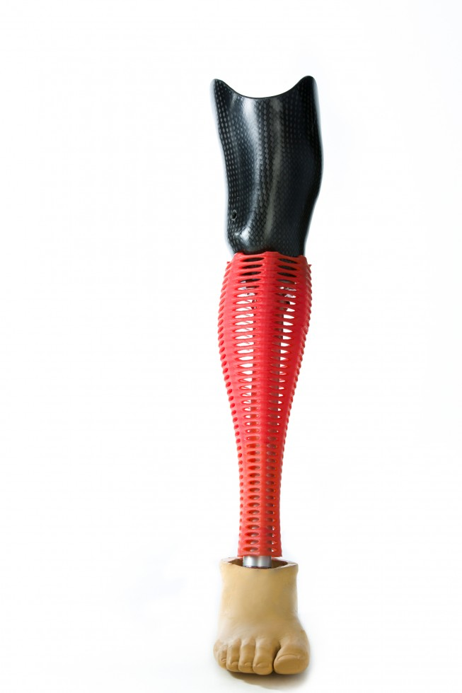 A 3D printed prosthetic cover on a prosthetic leg.