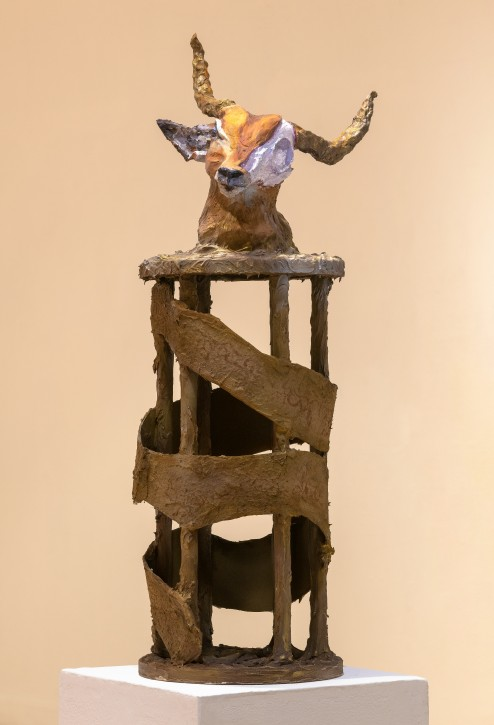 This is a sculpture with the head of a cow mounted on top