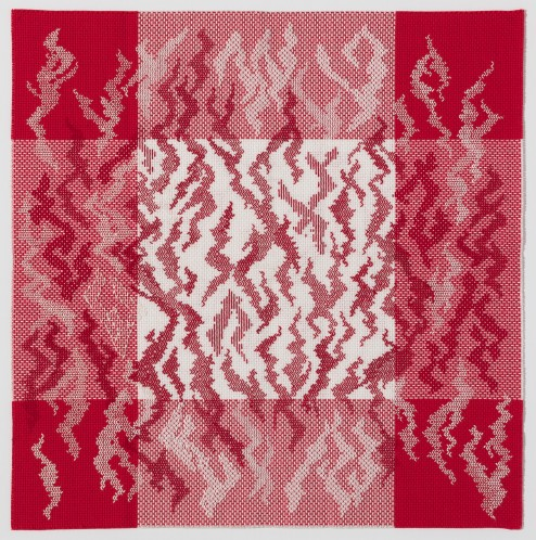 Woven fabric of checkered red and white covered in red squiggles.