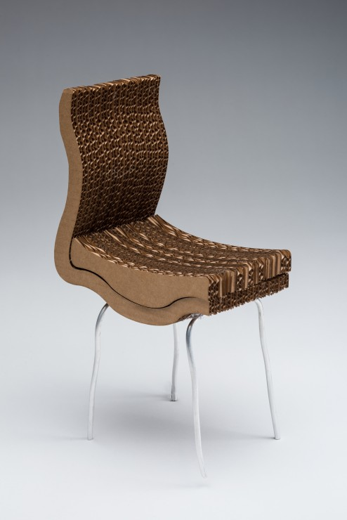Ergonomic chair with textured seating on grey backdrop