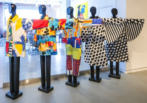 Multicolored Jackets and coveralls on black mannequins