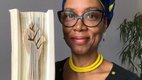 """Sonya with her most recent project, """"the solidarity book project"""" photo courtesy of Nicolas Colcott"""